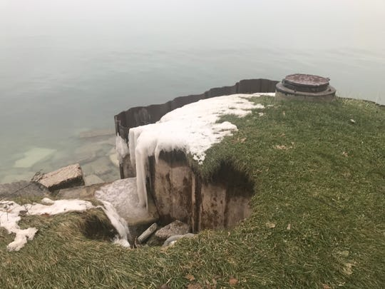 Waves from Lake Michigan have battered the Beach Drive shoreline, eroding about eight feet of bluff over the last four months. A sanitary sewer manhole is protected by sheet piling around the bluff.