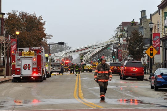 Fire crews battled flames in the attic of Heinz & Sons 57 Auto Body in downtown Grafton on Wednesday, Nov. 20.