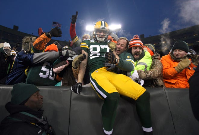 Green Bay Packers wide receiver Jordy Nelson (87) does the Lambeau Leap after scoring a touchdown against the 49ers after the 2013 season.