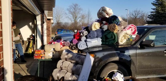 "Menomonee Falls native Charlie ""Bud"" Lomas and his wife, Patti, are honoring their son, CJ. by collecting socks and hats for Street Angels Milwaukee Outreach."