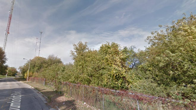 A stretch of North Humboldt Boulevard, just north of East Capitol Drive, is seen in Google Street View. Officers found underground bunker as well as guns, ammunition and debris on the west bank of the Milwaukee River near this site.