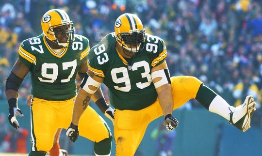 Green Bay Packers' Gilbert Brown (93) and Cletidus Hunt (97) react after Brown sacked San Francisco 49ers' quarterback Jeff Garcia in the first quarter of their NFC wild card playoff game Sunday, Jan. 13, 2002, in Green Bay, Wis.