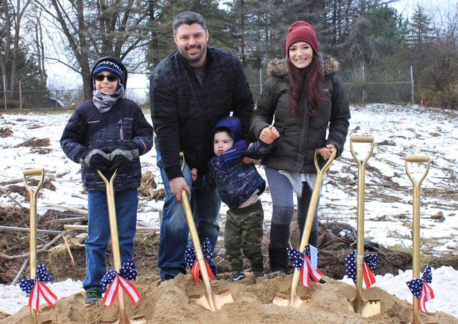 Sgt. Daniel Cappo, a veteran who is permanently disabled, and his family broke ground Nov. 16 in Menomonee Falls for a custom-built mortgage-free home from Operation Finally Home. Pictured are (from left) Hayden Cappo, Cappo, Danny Cappo Jr. and Jamie Cappo.