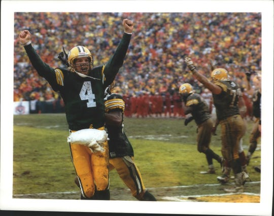 Packers quarterback Brett Favre shows his delight after Edgar Bennett's goal-line fumble was recovered by Antonio Freeman for a touchdown in the third quarter of the January 4 Divisional playoff win against San Francisco. The Packers defeated the 49ers that day, 35-14. January 29, 1997.