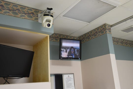 An intensivist with Mercy Hospital in St. Louis appears on a video screen Monday in one of Baxter Regional Medical Center's ICU rooms. The physician can use the swivel-mounted camera to the left of the video screen to look around the room or get a closer look at a patient. BRMC was recently awarded a Blue & You grant to upgrade the system.