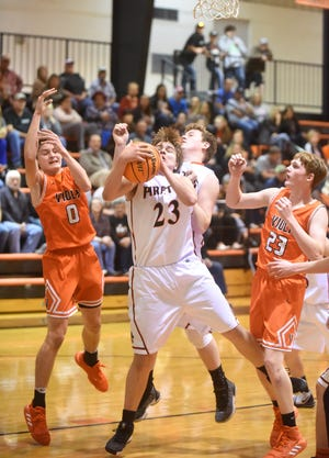 Calico Rock's Zane Fountain grabs a rebound between Viola's Blaine Marberry and Andrew Cantway on Tuesday night at Harold Ray Jeffery Gymnasium.