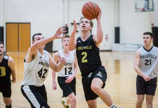 Daleville's Conner Fleming practices with teammates at Daleville High School.