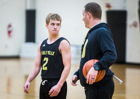 Daleville head coach Tyler Stotler with Conner Fleming during practice at Daleville High School.