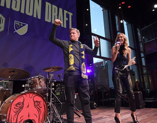 Nashville SC midfielder Dax McCarty cheers on the fans during MLS Expansion Draft at Ole Red on Broadway in Nashville on Tuesday, Nov.19, 2019.