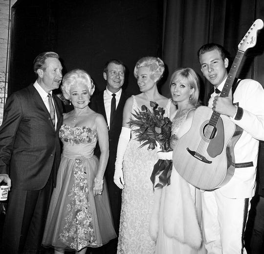 """Arthur O'Connell, left, Hortense Petra, Gene Nelson, Audrey Williams, actress Susan Oliver and Hank Williams Jr. gather at the Loew's Vendome Theater Nov. 6, 1964 for the Nashville premiere of """"Your Cheatin' Heart."""""""