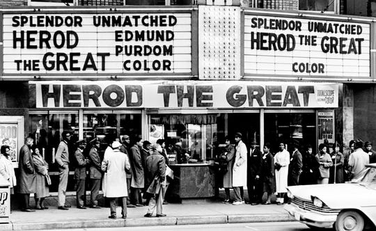 Several black students stood silently outside the Paramount Theater, one of the four downtown Nashville theaters, demonstrating for an end to racial barriers on Feb. 1, 1961.