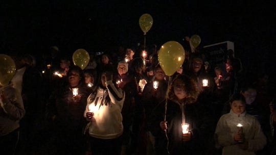 A vigil was held outside J.F. Kennedy Middle School on Tuesday evening in honor of a student who died Monday.