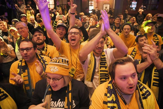 Nashville Soccer Club fan cheers during MLS expansion draft at Ole Red on Broadway in Nashville on Tuesday, Nov.19, 2019.