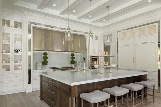 The kitchen of the Diamond private residence, Grand Aurora Award recipient for Best Kitchen Design – Custom/Spec/One of a Kind Home.