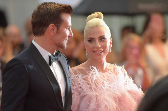 """Lady Gaga with actor Bradley Cooper. who co-starred in """"A Star Is Born."""""""