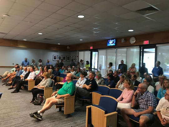 Residents attend a meeting at Naples City Hall Tuesday, Nov. 19, 2019, to discuss a proposal to allow dogs on a portion of the beach at Lowdermilk Park during certain times.