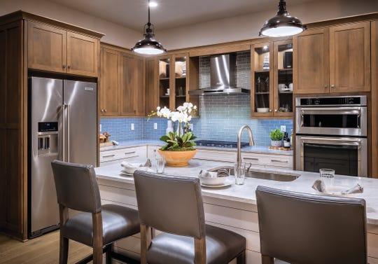 The 1,575 square-foot Baypointe villa at Azure at Hacienda Lakes features two bedrooms, two bathrooms, a gourmet kitchen and a two-car garage.