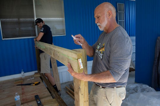 Volunteers Basford and Mike Nilles construct a handicap ramp for Fred and JoAnn Finn, Tuesday, Nov. 19, 2019, at the Finn residence in Bonita Springs.