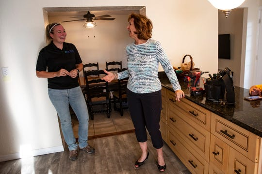 Casie Williams, left, an electrician and owner of AV Tech, and Marie Elaina Mullin, director of Wounded Warriors of Collier County, talk during a tour of the organization's first transitional house for homeless veterans, Tuesday, Nov. 19, 2019, in River Park.
