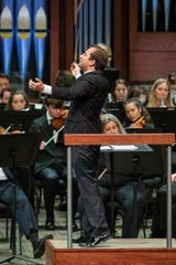 Radu Paponiu conducting the annual concert that pairs Philharmonic musicians with top students