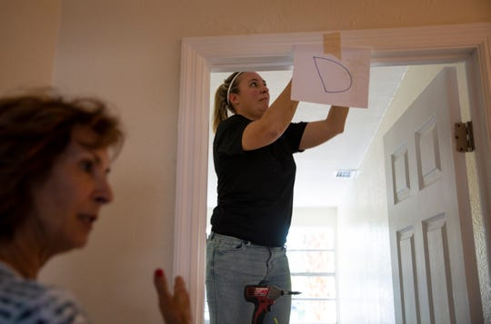 AV Tech electrician Casie Williams, right, works on an electrical project, during a tour of Wounded Warriors of Collier County's first transitional house for homeless veterans, Tuesday, Nov. 20, 2019, in River Park.