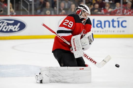 New Jersey Devils goaltender Mackenzie Blackwood (29) makes a save during the first period of the team's NHL hockey game against the Boston Bruins, Tuesday, Nov. 19, 2019, in Newark, N.J.