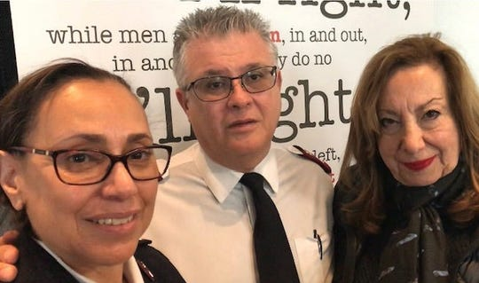 Salvation Army Majs. America and Miguel Barriera and board member Penelope Surgent inside the chapel of the Passaic mission building.