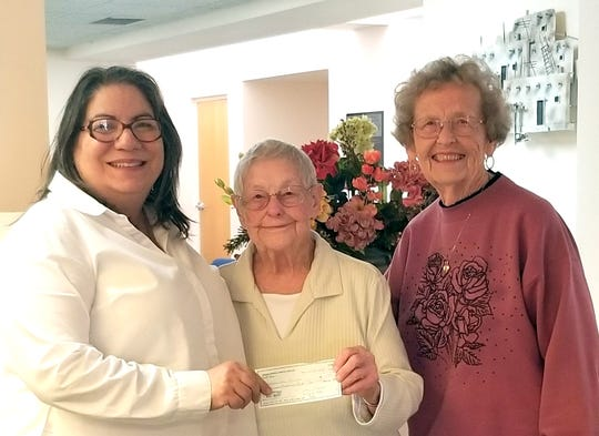 The Mimbres Memorial Hospital Auxiliary in Deming, NM made a donation of $10,000 to the Deming Senior Citizen's Center at 800 S. Granite St. Senior center director Julie Bolton said the money will be used toward the purchase of a mini van equipped with a wheelchair ramp. Pictured, from left, are Julie Bolton, with MMH Aux. members Alice Dunham and Virginia Pool.
