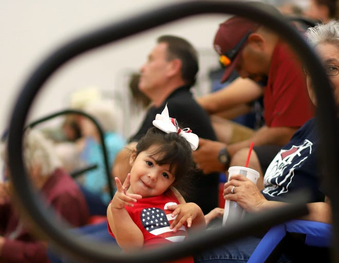 Sophia Maite, 2, is framed by the bleacher hand-railing during a recent Lady Wildcat volleyball match at Deming High School. Maite was a frequent fan to Lady 'Cat sporting events but showed little interest in the action on the court. She was usually accompanied by her grandmother Lupe Morales.