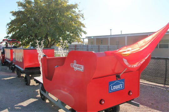 Lowe's Home Improvement Store donated the lumber to fix some of the cars on the Toys for Tots train.