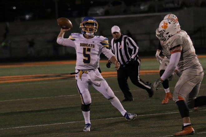 Bloomfield's Vince Marquez fires a pass down the right side against Aztec during a District 1-4A football game on Friday, Nov. 1, 2019, at Fred Cook Memorial Stadium in Aztec.