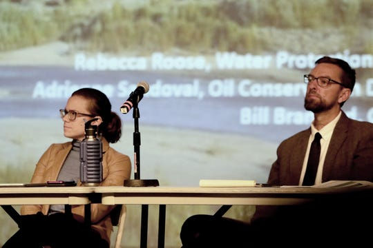 Oil Conservation Division Director Adrienne Sandoval and Owen Kellum, an attorney for the New Mexico Office of the State Engineer, participate in a discussion, Tuesday, Nov. 19, 2019, about produced water.