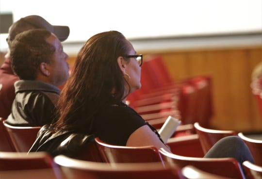 Audience members listen to comments, Tuesday, Nov. 19, 2019, during a meeting about produced water at San Juan College.