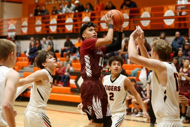 Shiprock's Trevor Etcitty shoots and makes a contested basket against Aztec during a District 1-4A boys basketball game on Thursday, Jan. 31, 2019, at Lillywhite Gym in Aztec.