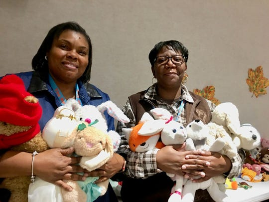 Regina Harrison, mentor for New Foster Care, and her colleague Latrice Marshall hold some of the cuddly stuffed animals available for the foster or adoptive children to take home from the Thanksgiving event. Foster families, adoptive families and kinship families were invited to attend the Thanksgiving Gathering to thank them for their care.