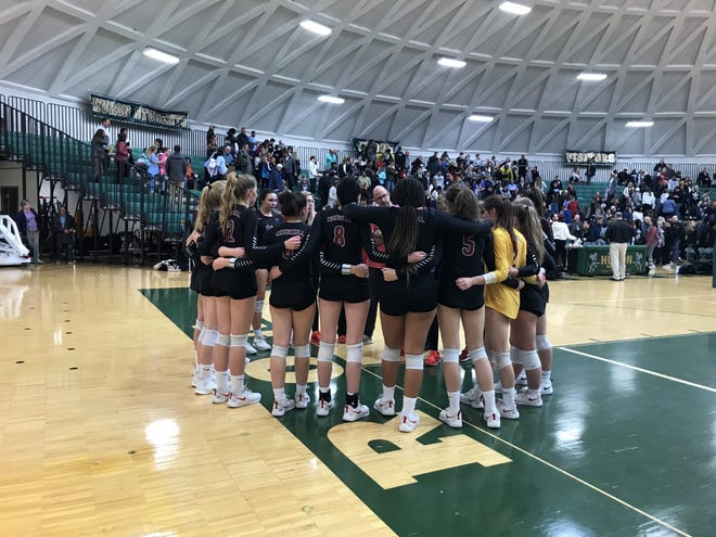 Livonia Churchill circles up after its three-set loss to Ann Arbor Skyline in the state quarterfinal.
