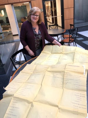 Susan Choma of Novi shows massive family trees on her father's side for the Andrus and Williams branches.