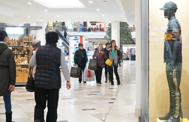 Shoppers stroll through the halls of Novi's Twelve Oaks Mall on Nov. 19.