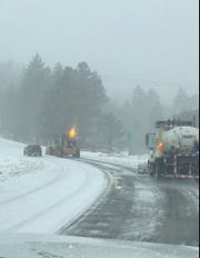 A snow plow clears a road in the San Bernardino National Forest on Wednesday, Nov. 20, 2019. Caltrans is advising motorists to use chains on their tires if driving into local mountains as a storm hits Southern California.
