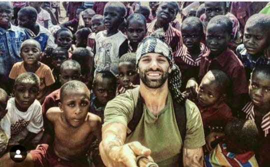 College of the Desert head baseball coach Sam DiMatteo takes a selfie photo with youths at an orphanage near Zimbabwe, Africa, on Oct. 4, 2017, during a trip for the SD Project. The program assists young athletes in need, whether it be financial struggles, family traumas, equipment shortages, or kids dealing with mental or physical handicaps.