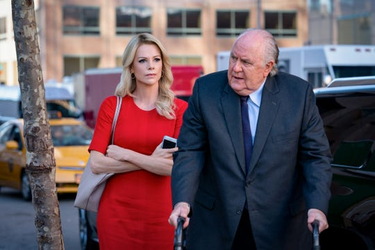 "Charlize Theron (left) as Megyn Kelly and John Lithgow (right) as Roger Ailes in the 2019 film ""Bombshell."""