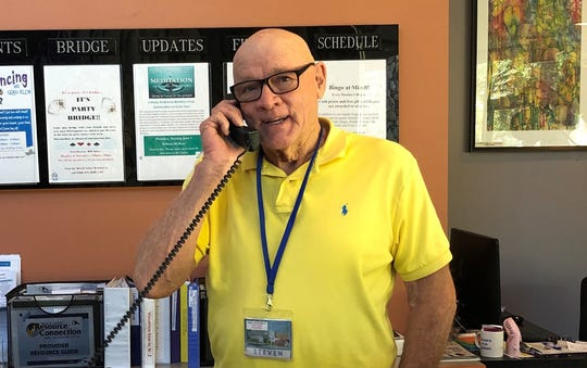 Volunteer Steven Steer doing what he loves to do: greeting people at the Mizell Center.