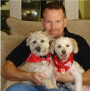 Richard Waxman shows off Lucky and Scruffy, the original canine ambassadors.