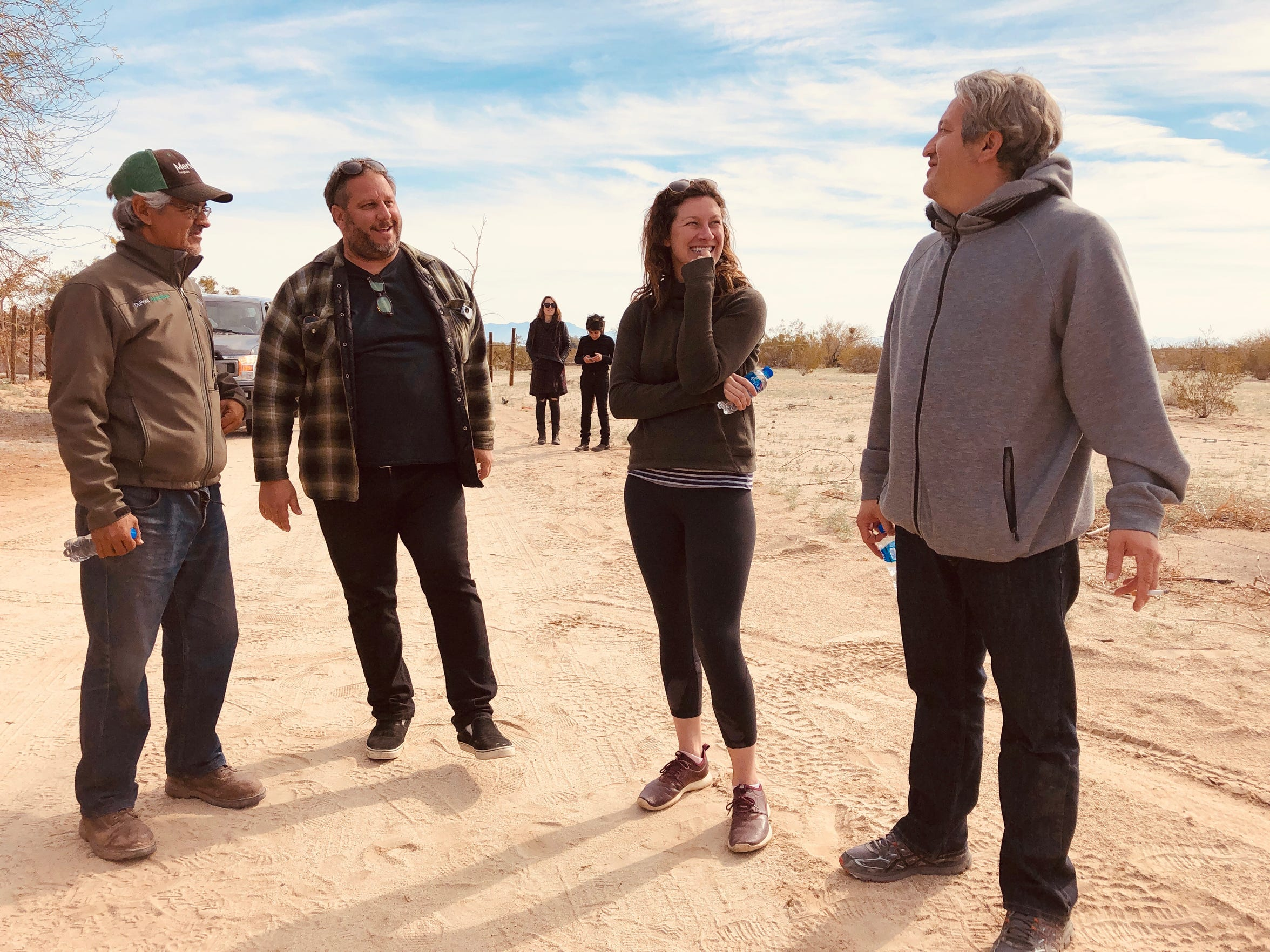 Desert Sun features editor Kristin Scharkey (second from right) and photojournalist Omar Ornelas (far right) in Laguna Salada while reporting on the lost ship of the desert. The pair traveled throughout Baja with the help of farmer Arturo Guerrero Cortés (far left) and road trip expert Rick Marino (second from left).