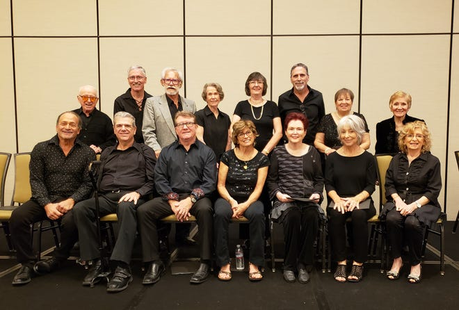 The SongShine Singers sit down with Ruthanna Metzgar (back row, far right) and Peter Harris (front row, far left).
