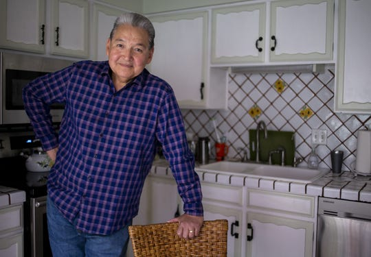 Former Phoenix television anchor Frank Camacho poses for a portrait in his home on Nov. 19, 2019, in Phoenix.
