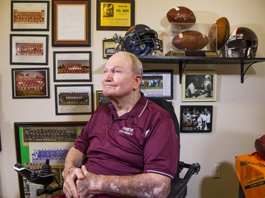 Karl Kiefer spends time in his office at an assisted living facility in Chandler, Thursday, August 29, 2019.  Kiefer was the head football coach at McClintock high school 30 years ago when he took them to the state championship. He later became the head coach at Mountain Pointe High School in Ahwatukee.
