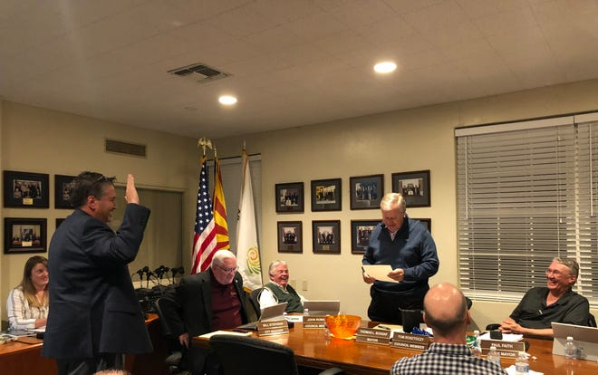 Ron Clair takes the oath of office as Litchfield Park's newest City Councilman. He replaces longtime councilman Peter Mahoney, who resigned in October.