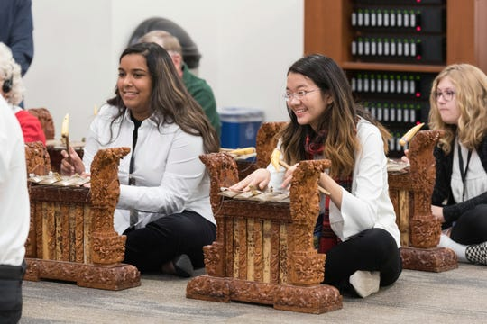 Visitors learn how to play the gamelan at MIM's 'Tis the Season holiday event in 2018.