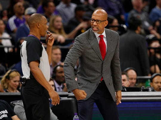 Phoenix Suns head coach Monty Williams, right, questions referee Michael Smith, left, about a play during the first quarter of an NBA basketball game against the Sacramento Kings in Sacramento, Calif., Tuesday, Nov. 19, 2019.